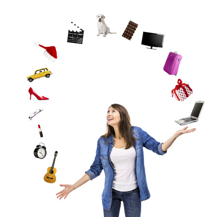 juggle: Happy woman trying to catch something falling from the sky Stock Photo