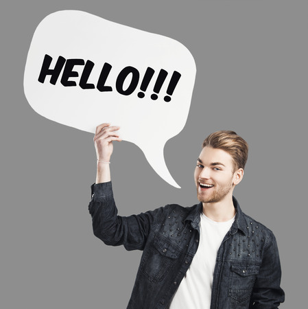 Good looking young saying Hello with a  speech balloon photo