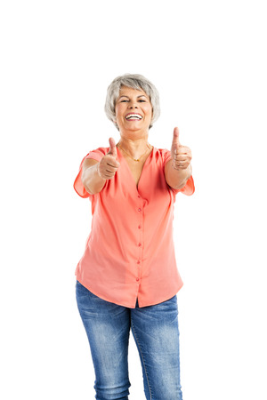 gaiety: Portrait of a happy old woman with thumb up, isolated on a white background