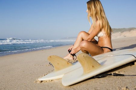 surf girl: Beautiful woman on the beach getting ready for surf