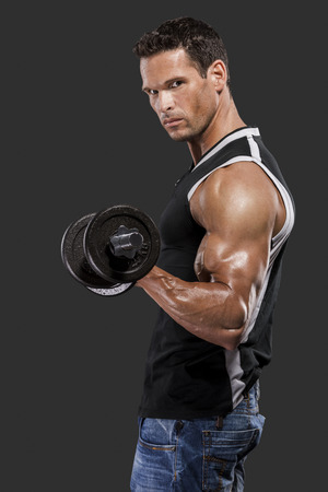 Muscle man lifting weights, isolated over a white background