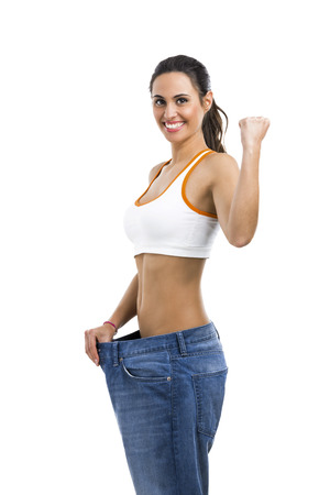 loose: Woman with large jeans in dieting concept Stock Photo