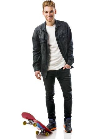 swag: Studio portrait of a young man posing with a skateboard