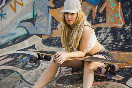 sexy teen girl: Beautiful and sexy street girl with her skateboard