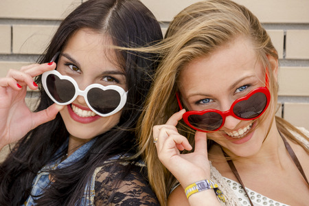 naughty girl: Two beautiful teenage girl wearing funny sun glasses