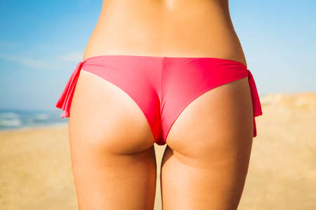 young girl bikini: Butt view of a sexy woman in bikini Stock Photo