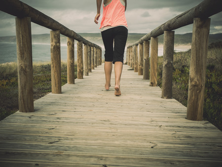 healthy path: Beautiful and healthy woman running on a path