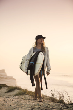 surf girl: Beautiful female Surfer looking for the waves