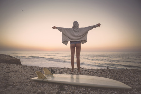mediate: A beautiful girl at the beach with her bodyboard