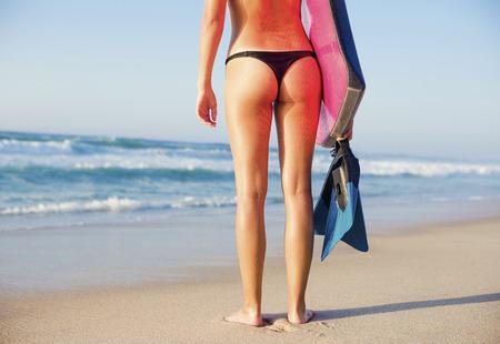 bodyboarding: A beautiful girl at the beach with her bodyboard