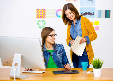 work from home: Women working at desk In a creative office, team work