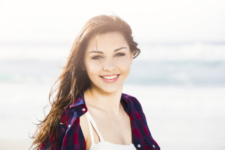 smilling: Portrtait of a happy girl at the beach smilling