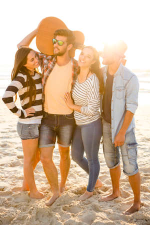 having a break: Friends  at the beach having fun together Stock Photo