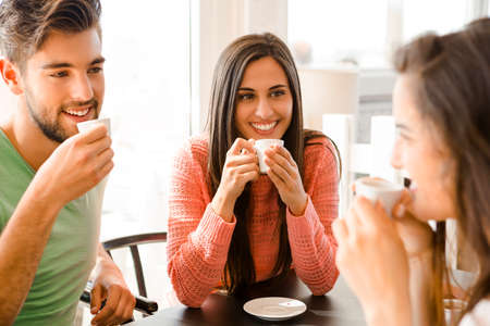 talk: Friends having a great day at the local coffee shop Stock Photo