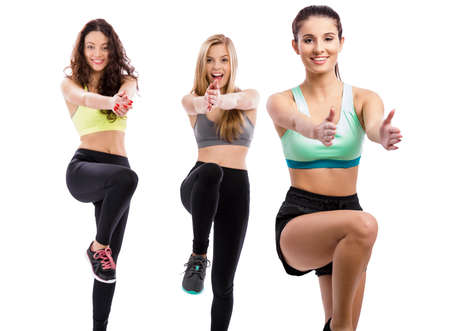 teen dance: Portrait of three beautiful athletic girls making group exercises Stock Photo