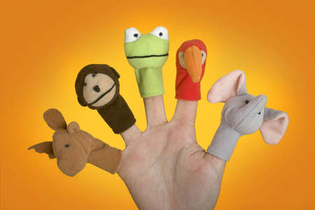 Female hand playing with puppets on the fingers Stock Photo