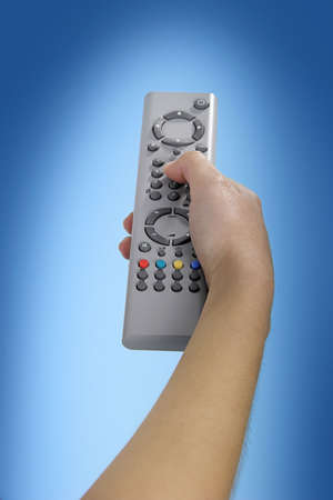 tv remote: Human hand olding a tv remote control