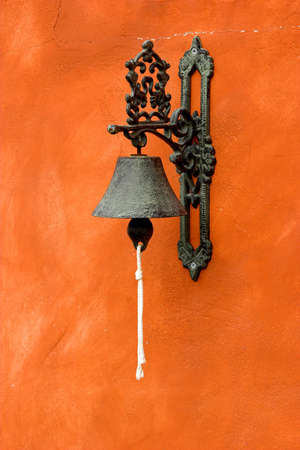 sonorous: Old vintage bell on a orange wall