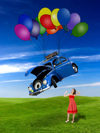 lady beetle: Woman witing for a beetle car falling from the sky with ballons Stock Photo