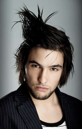 men hairstyle: Good looking  young man with modern HairStyle Stock Photo