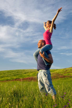 the carefree: Young couple having good time on a beautiful springfield Stock Photo