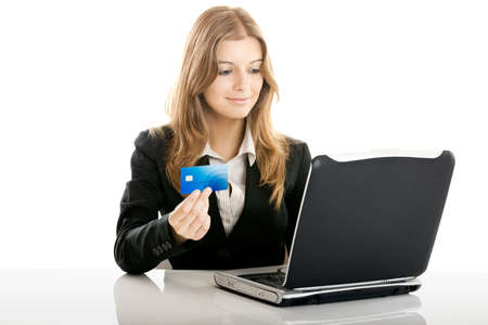 buying: Portrait of a beautiful woman shopping online using a credit card