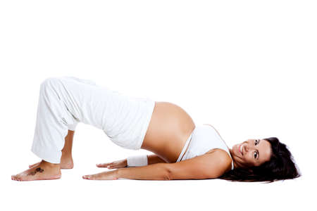 pregnant woman yoga: Pregnant woman making fitness exercises, isolated on white