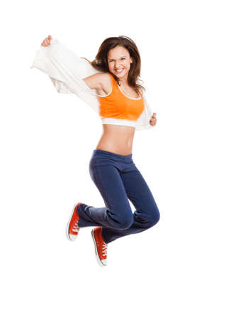 perfect smile: Portrait of a beautiful and athletic teenage girl jumping isolated on white