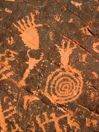 anasazi: 3,000 year old Native American petroglyphs carved in red sandstone in the southwestern USA desert. Stock Photo