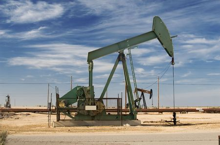 horsehead pump: A producing oil well in a California Central Valley oilfield. Stock Photo