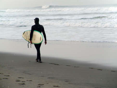 dreary: Its never too cold to go surfing in Northern California. Stock Photo