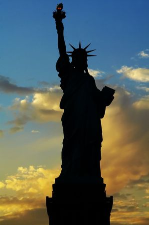 immigrate: Liberty statue silhouette at dusk