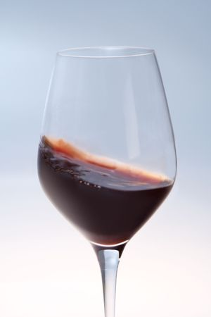 nebbiolo: A glass of red wine being swirled