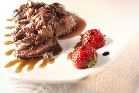 balsamic: Sliced Angus filet mignon with crispy Colonnata fatback on a strawberries and balsamic vinegar sauce