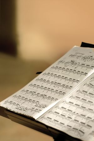 allegro: Music stand holding a sheet music in a concert hall