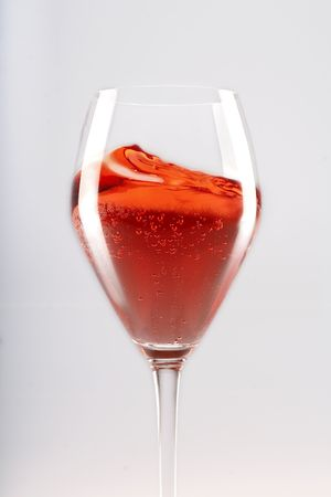 nebbiolo: Glass of sparkling ros� wine being swirled Stock Photo