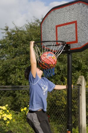 Active boy game of basketball photo