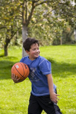 Active boy game of basketball Stock Photo - 561227