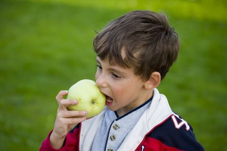 Beautiful boy with apple and ball photo