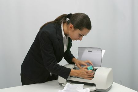girl with a wristwatch: Business woman is  printing in office Stock Photo