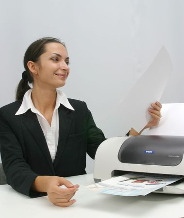 ling: Business woman is  printing in office Stock Photo