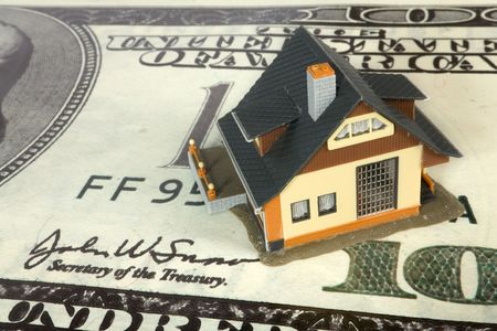 house on big dollar banknotes. Stock Photo