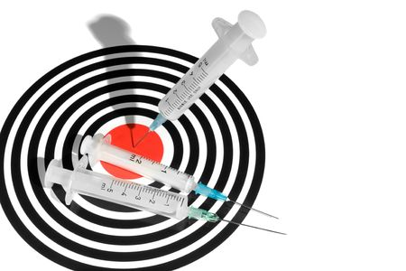 pinpoint: Syringe in a Dartboard. Medical Related Concept