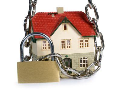 House  locked with padlock on white background Stock Photo - 5025044