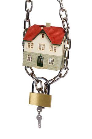 House  locked with padlock on white background Stock Photo - 5024862