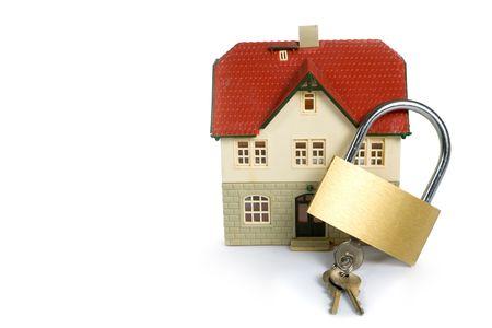 House  locked with padlock on white background Stock Photo - 5024904