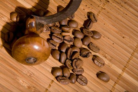 Old coffee grinder with coffee grain photo