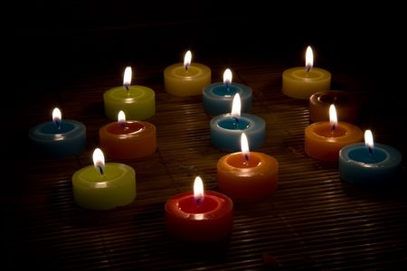 Many candles on a black background Stock Photo - 5034754