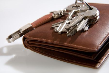 doorkey: bunch of keys on brown leather wallet