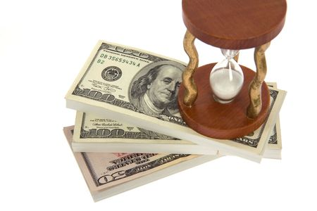 Dollar and hourglass on white background photo